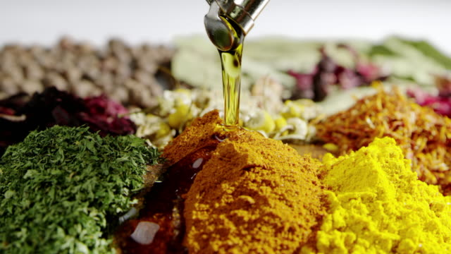 pouring oil herbs cooking slow motion food seasoning ingredient tasty - naturopathy stock videos and b-roll footage