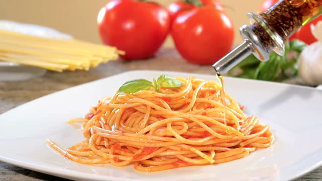 pouring olive oil over spaghetti spaghetti with parmesan cheese and tomato sauce macaroni stock videos & royalty-free footage