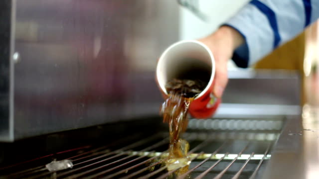 Pouring Out Fountain Drink Soda is poured into the drain at a restaurant drink fountain. soda stock videos & royalty-free footage