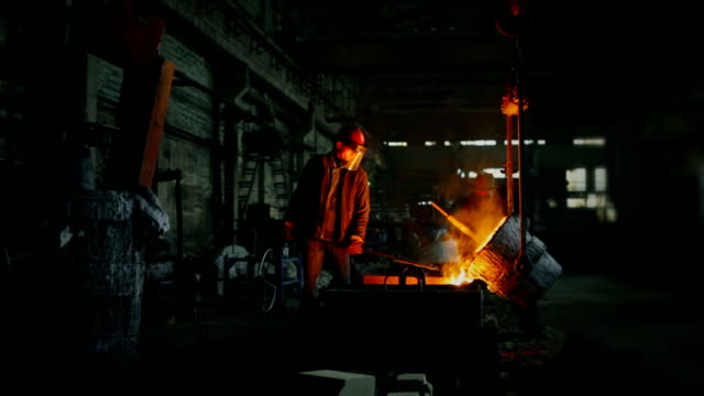 Pouring out of the melted metal in a form Liquid metal in the factory foundry foundry stock videos & royalty-free footage