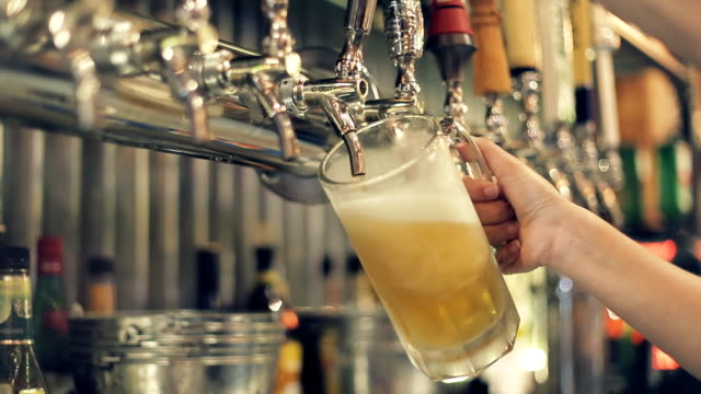 Pouring Perfect Draft Beer. A beer tap is a valve, specifically a tap, for controlling the release of beer video