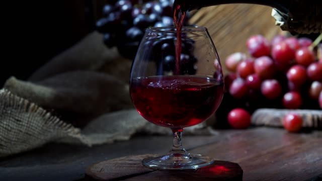 pouring red wine cinemagraph - bacca video stock e b–roll