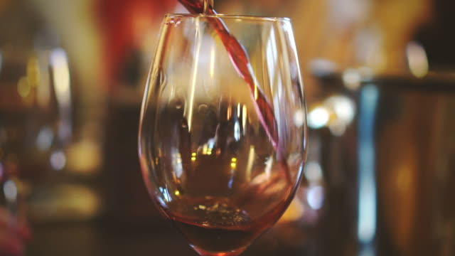 Pouring red wine from bottle into glass. Wine degustation. video