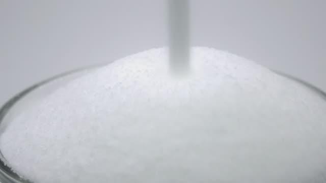 Pouring salt -4K- video