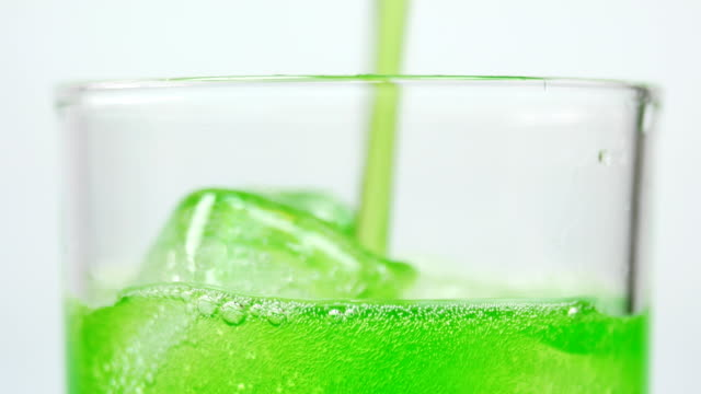 pouring soft drink green apple - healthy green juice video stock e b–roll