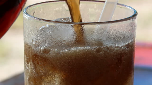 pouring soft drink Close-up pouring soft drink soda stock videos & royalty-free footage