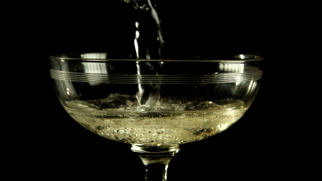 Pouring sparkling wine in champagne coupe video