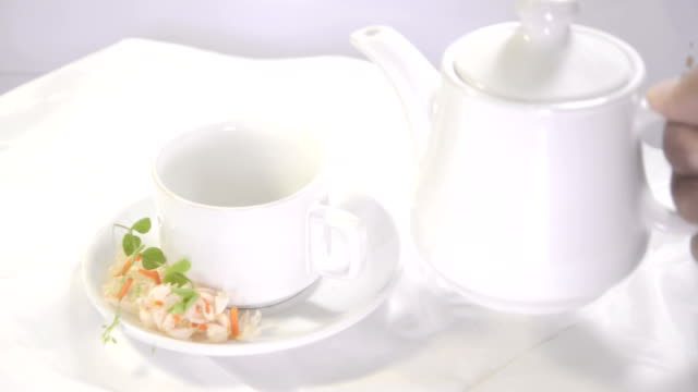 Pouring tea into cup video