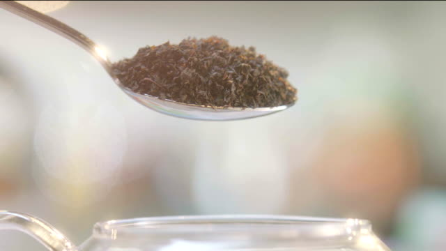 Pouring tea leaves in teapot video