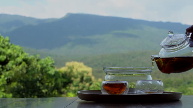 pouring tea - tea cup stock videos & royalty-free footage