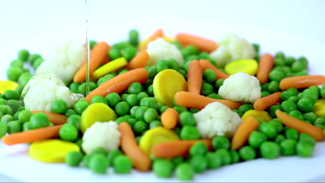 Pouring The Oil Over Vegetables (Super Slow Motion) video