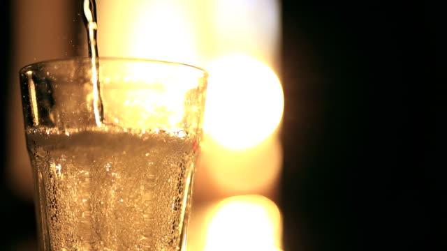 Pouring tonic into a glass