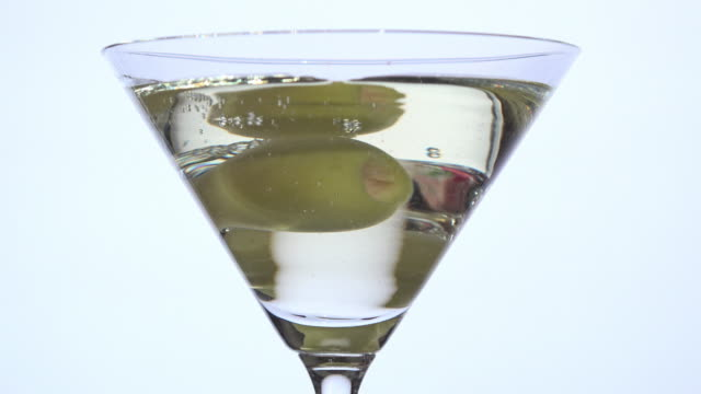 Pouring vermouth dry over olive video