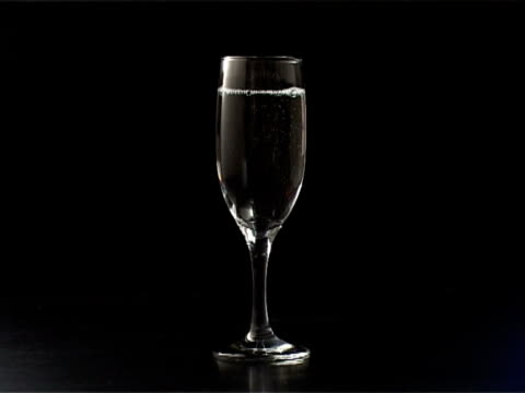 Pouring water in thin champagne glass video