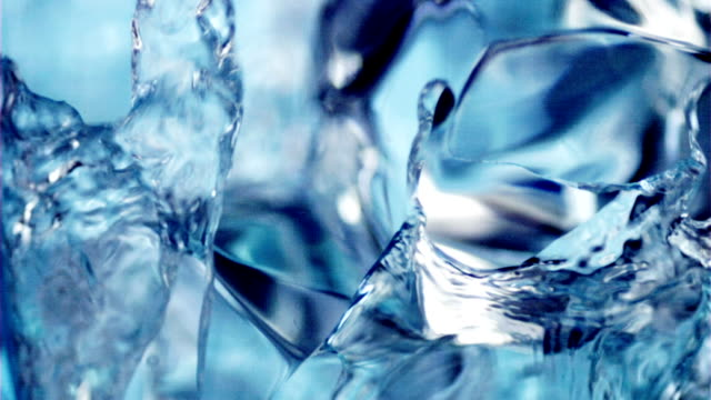 Pouring water into a glass with cubes of ice. Pouring water into a glass with cubes of ice. Slow motion 600 fps. 2 takes. Macro. ice stock videos & royalty-free footage