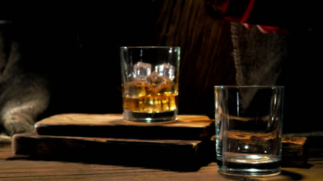 pouring whiskey next to the barrel - whisky video stock e b–roll