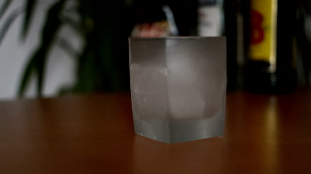 pouring whisky in with ice