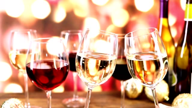 Pouring wine at Christmas party. video