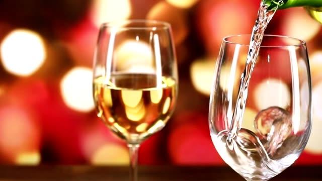hälla vin på julfest. - vitt vin glas bildbanksvideor och videomaterial från bakom kulisserna