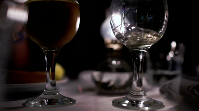 Pouring wine into empty glass in restaurant video