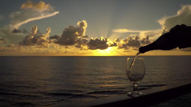 vídeos y material grabado en eventos de stock de verter el vino en el agua - yacht