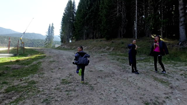 Pov chasing young boy on mountain video