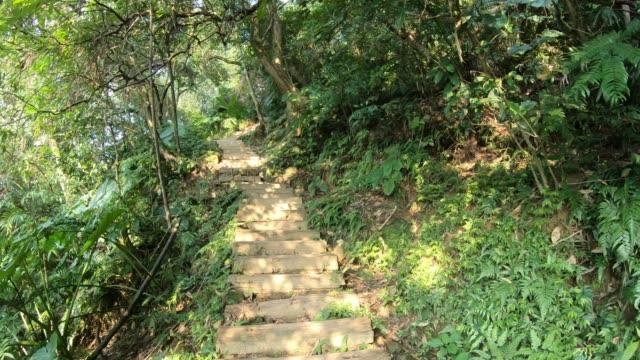 4K Pov of climbing long rock stairs on Xindian mountain Taipei city, Taiwan
