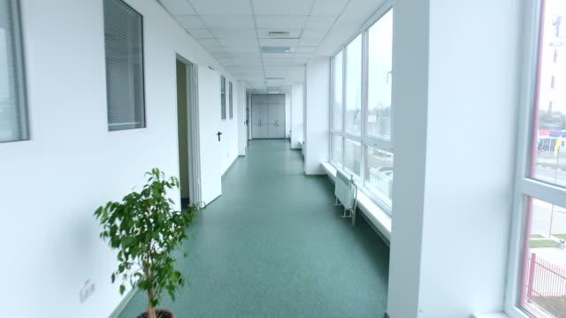 Pov of walking lab corridor. Steady cam shot of laboratory corridor video