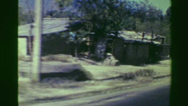 1976: Poverty housing shacks roadside travel ghetto 3rd world view. video