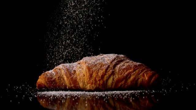 Powdered sugar sprinkling onto a croissant video