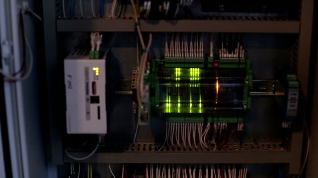 Power cable connected to a circuit breaker in the electrical cabinet video
