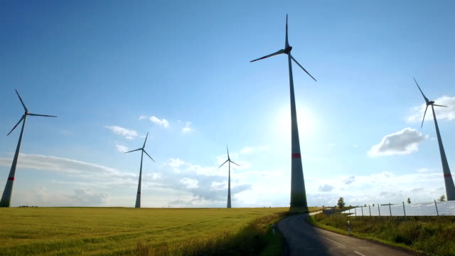 power generating wind turbines and modern solar panels in the countryside video
