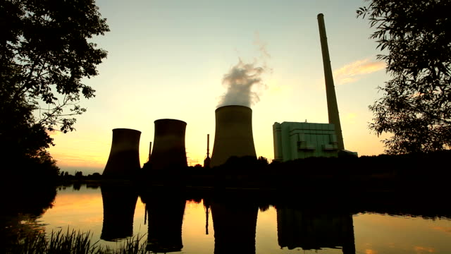 Power plant in sunset video
