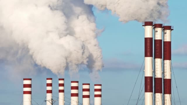 power plant smokes. air pollution. video