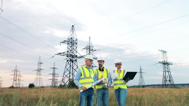 Power plant specialists discussing a power station video
