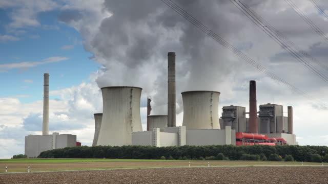 crane down: power station - tilt down stock videos & royalty-free footage