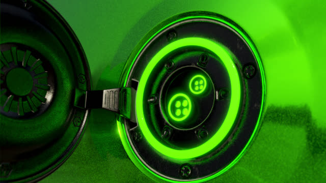 power supply connecting to the green electric vehicle for charging a battery. 3d rendering motion graphic for eco-friendly alternative energy concept. - carica elettricità video stock e b–roll