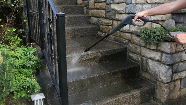 Power washing on outdoor concrete staircase in front yard garden movie 1080p