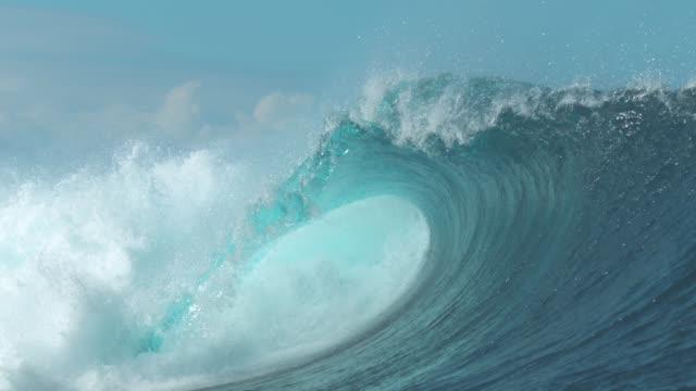 SLOW MOTION: Powerful Cloudbreak wave violently swirls in cool sunny weather.