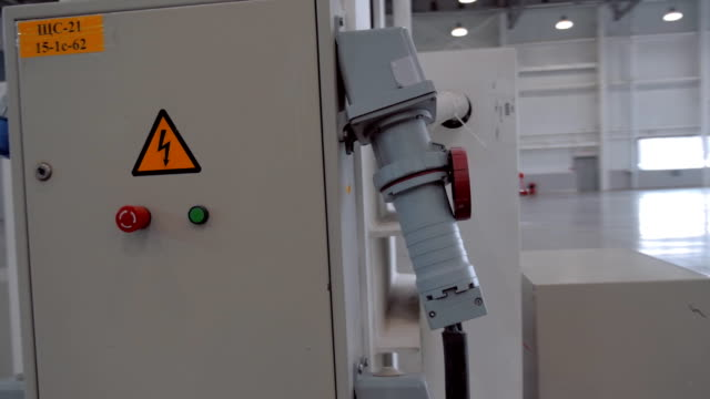 Powerful industrial electrical cabinet with hazard icon and large connector Powerful industrial electrical cabinet with hazard icon and large electrical connector. Shot in motion high voltage sign stock videos & royalty-free footage