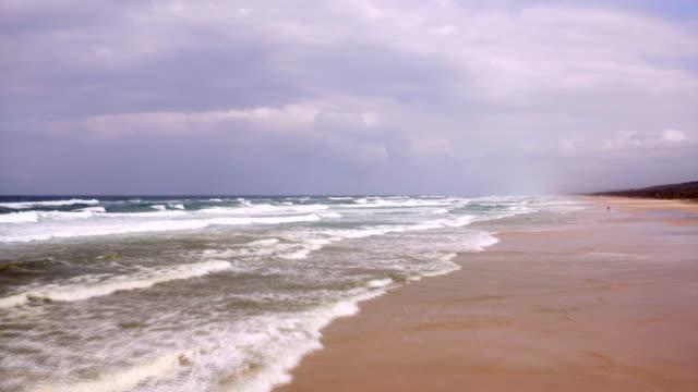 AERIAL: Powerful waves breaking on the coast of Australia video