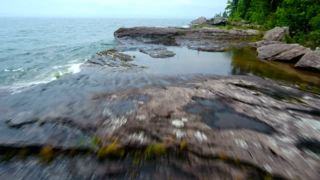 Powerful waves smashing on the rocks along the shores of Lake Michgian video