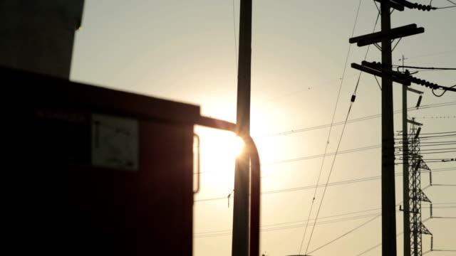 powerline och solnedgång. - skylift bildbanksvideor och videomaterial från bakom kulisserna