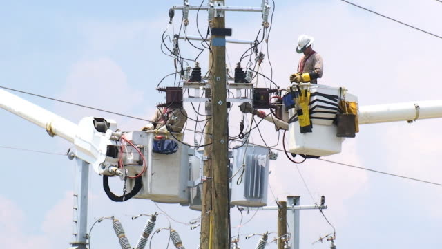 Powerline Workers Electrical workers in bucket trucks. power stock videos & royalty-free footage