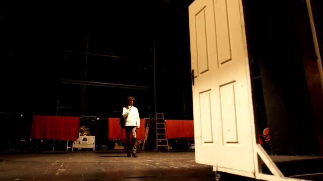 Practice the scene before performance There is one young man, age 23. He is in theater and he have a rehearsal. He is an actor, he have a curly hair. actor stock videos & royalty-free footage