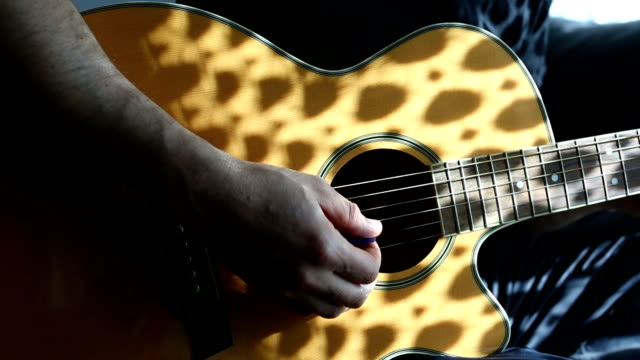 Practicing acoustic guitar Practicing acoustic guitar side lit stock videos & royalty-free footage