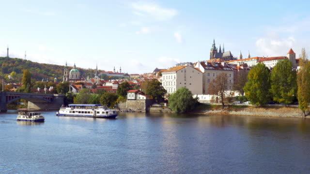 vidéos et rushes de prague skyline with vltava river and hradcany hill - saint nicolas