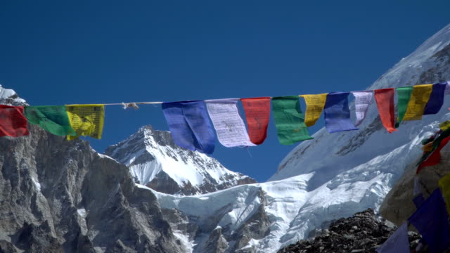 Prayer flags against the background of the Everest video