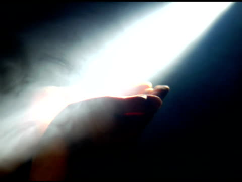 Praying hands in light and fog video