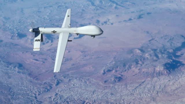 vídeos de stock, filmes e b-roll de predator tom - avião sem piloto